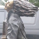 An as-yet unnamed sculpture by Gardiner artist and gallery owner Mack Holman was placed next to the flag pole at Siuslaw Public Library in early March 2013.