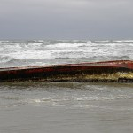 Volunteers spotted a non-motorized boat adrift in the surf north of Florence, March 14th, 2013.  (Oregon Parks and Recreation Photo)