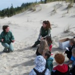 Field rangers, Eliza Spear (left) and Meghan Avila (right) teach Siuslaw Elementary 2nd graders about Snowy Plovers in an activity called the Snowy Plover Survival game. (U.S.F.S photo)