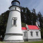 The 'new' old look of the Heceta Lighthouse after restoration.  A window midway up the tower had been enclosed for decades.  (Oregon Parks and Recreation photos)