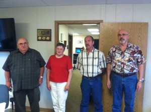 New Port of Siuslaw Commissioners stand to be sworn in during a special meeting held July 1st.  Left to right, Ron Caputo, Nancy Rickard, Terry Duman and Jay Cable.