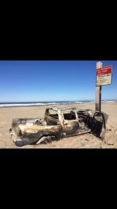 Authorities are trying to determine who the owner of a burned out pickup is. It was discovered on the beach, about two miles south of the Siuslaw River near Florence September 27th. It's believed to have been stolen. (photo by Pete Warren)