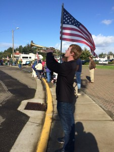 18-year old Asa Puckett, formerly of Little Rock, AR and now living in Yachats was one of four trumpet players blowing Taps along the route of Wednesday's Veteran's Day Parade in Florence.