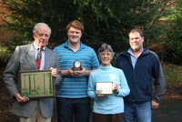 Area residents Dave and Diane Rankin were recognized by the Oregon Tree Farm System as Oregon Tree Farmers of the Year this week. Dave Rankin (l.) is standing with their grandson Riley, Diane Rankin, and the son Dan Rankin (r.).